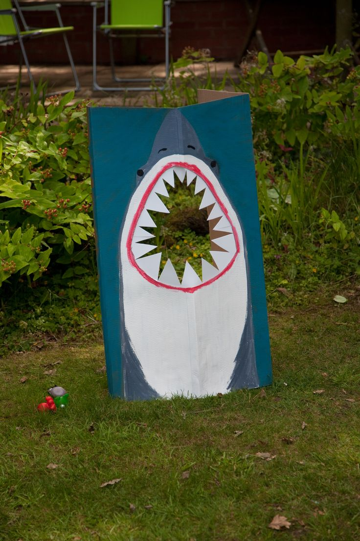 Under the sea party photo opportunity and game (throw the fish in hte shark's mouth)