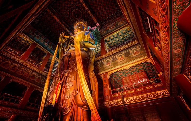 This thing was a pleasure to photograph! While I was in this temple, monks were taking huge long red sashes and walking around the upper areas and draping them around different parts of the enormous statue. It was all in slow motion and most interesting! - Beijing, China - Photo from #treyratcliff Trey Ratcliff at http://www.StuckInCustoms.com