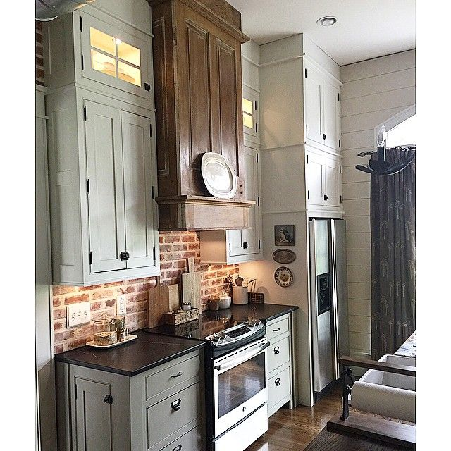 oven hood made of two antique doors. cut one of the doors in half to make the sides, and added barn wood to trim it out. added a dark wax once up to the raw wood.
