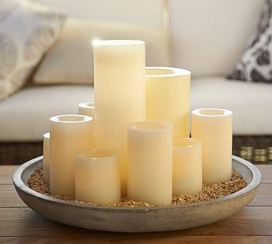 Trays can work in many ways as an accent to any home and here's another example: a tray used for a candle display Cement Candle Tray #potterybarn