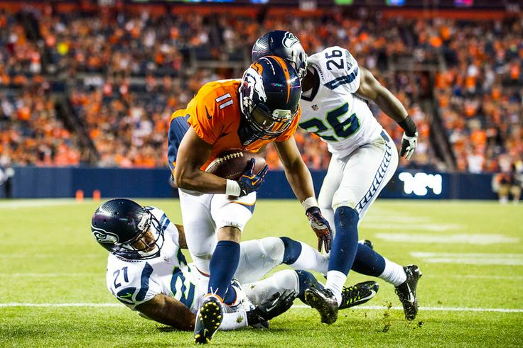 Description of . Jordan Norwood (11) wide receiver of the Denver Broncos runs in for a touchdown during a preseason game between the Denver Broncos and the Seattle Seahawks at Sports Authority Field at Mile High on Thursday, August 07, 2014 in Denver, Colorado.  (Photo by Kent Nishimura/The Denver Post)