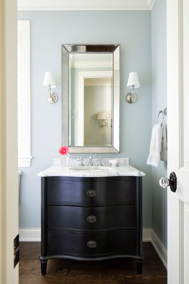 Powder room paint color is Seafoam by Benjamin Moore. The countertop is Venatino Granite.