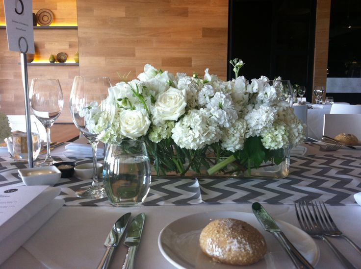 Tank vases, yours would be more natural looking with foliages and berries! | By Flower Jar