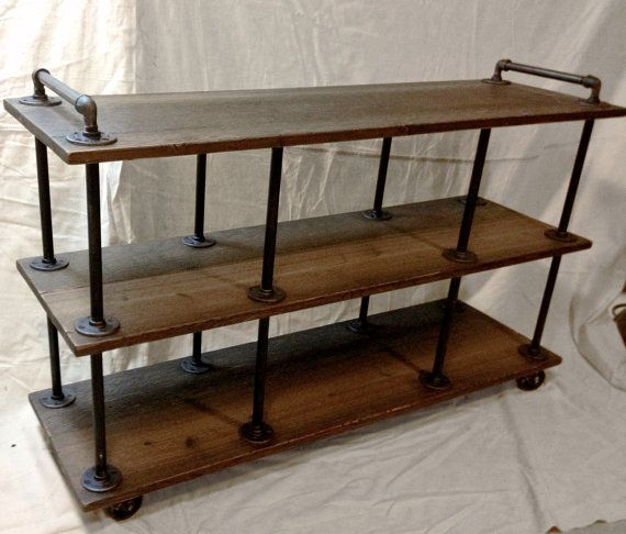 This beautifully finished Industrial Iron and Wood TV Stand is made from rough-cut cedar, iron pipe, and iron fittings. The sturdy shelves sit