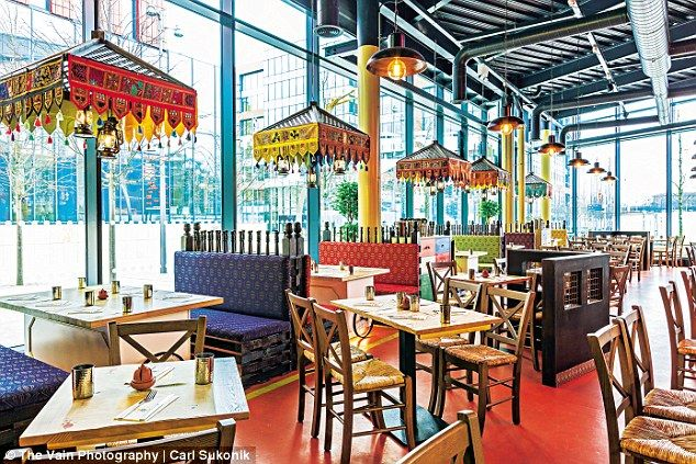 The Indian Tiffin Room is vast, modern, cavernous and airy, with various neon light instal...