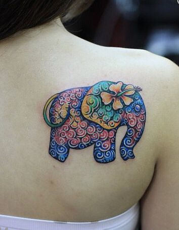 Colourful elephant tattoo it's different and bright the colours work great together and looks just beautiful.