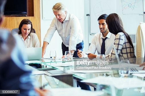 Stock Photo : Business people having meeting in conference room, using laptop and discussing