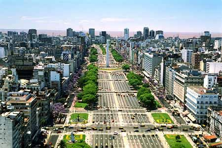 Avenida 9 de Julio... yes there are A LOT of lanes.  If you catch the lights right and walk very fast and have a little luck (ie no car coming!) it is possible to cross it in one shot.