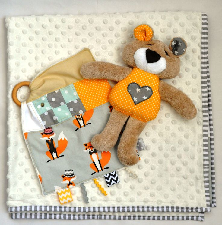 Soft baby shower pack with quilted baby blanket, a sweet teddy bear and taggy toy
