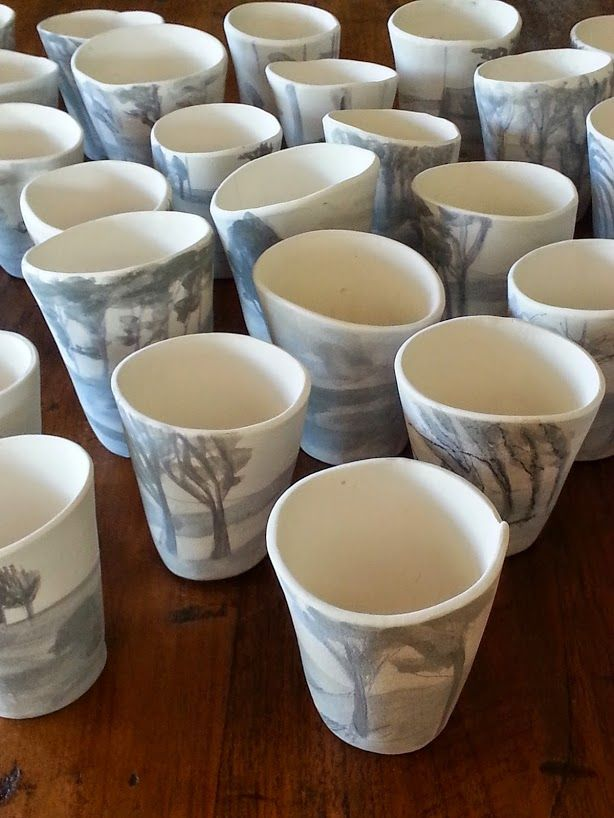 bisqued cups from kiln