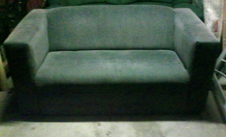 2 seater grey lounge good condition $50 or nearest offer.