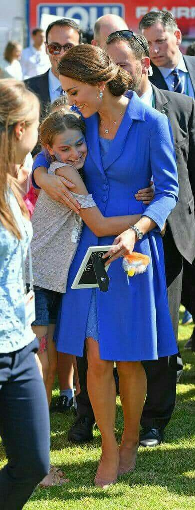 Kate hugs one of her adoring fans.
