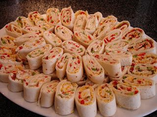 Salsa/cream cheese pinwheels!10 large flour tortillas 1 cup chopped veggies - I like using red and green peppers, red onion, and celery. 1.5 blocks cream cheese, softened 1 package dry ranch dressing mix 1/4 cup salsa 1/2 cup shredded cheddar cheese