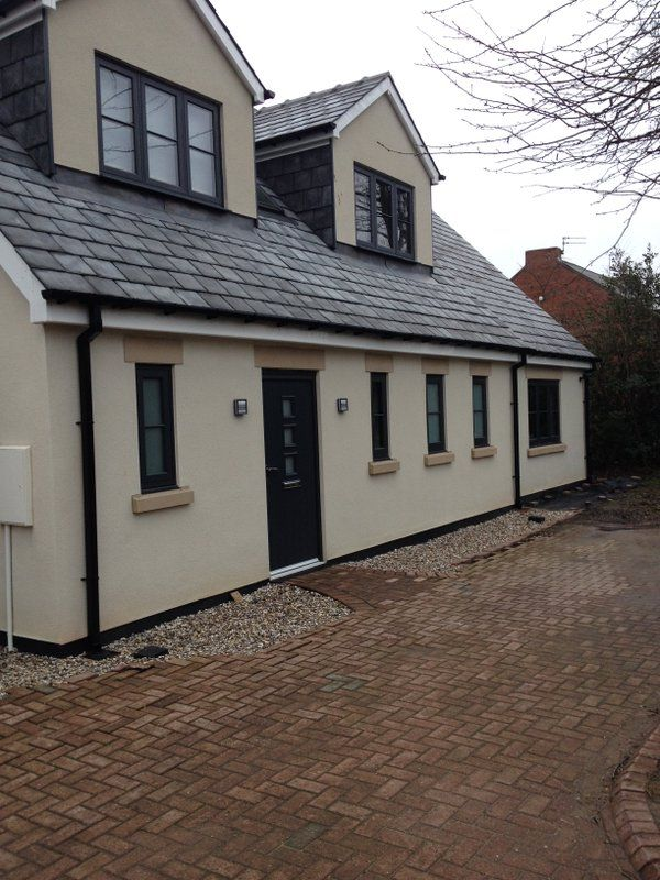 Anthracite Grey Windows and Solidor Composite Front Door Supplied & Installed by National Window Systems. Contact us for a quote on 01325 381630 or sales@nationalwindowsystems.co.uk Grey Windows / Contemporary House / Rendered House / Home / Stone Cill / Coloured Windows / Georgian Bar / Modern Front Door / Composite Door / uPVC Windows