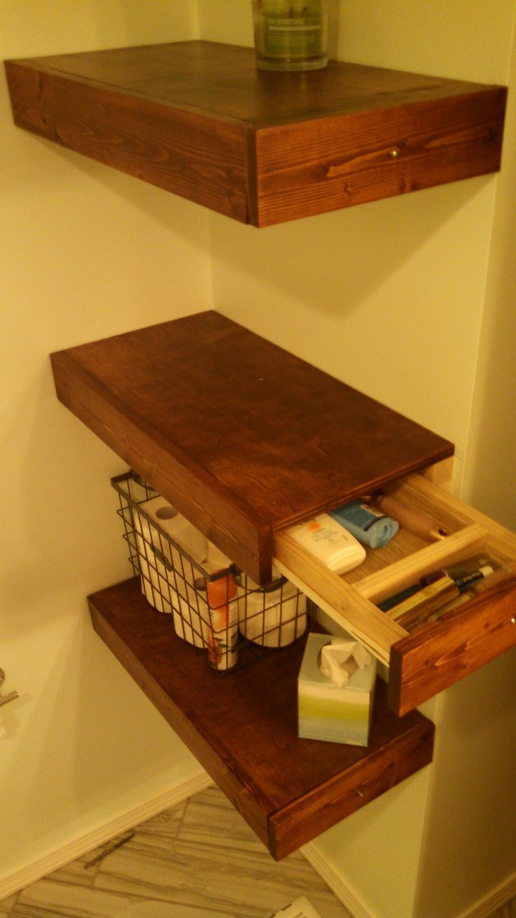 DIY floating shelves with drawers.