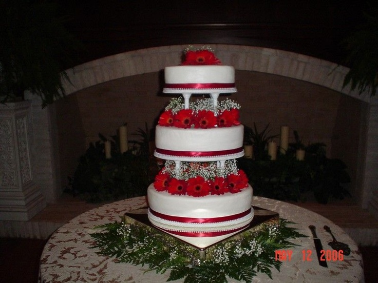 Oval shape 3 tier wedding cake - Cake was covered with buttercream icing.  Bottom tier, lemon poppy seed; middle tier, almond poppy seed; top tier, Italian creme with roast pecans.