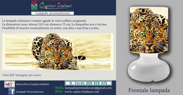 Lampada da tavolo in vetro soffiato a bocca, personalizzata con l'immagine di un leopardo. Altezza 24,5 cm- diametro base 15 cm- diametro paralume 14 cm - lunghezza filo elettrico 2 mt. La lampadina non è inclusa (max 40W).