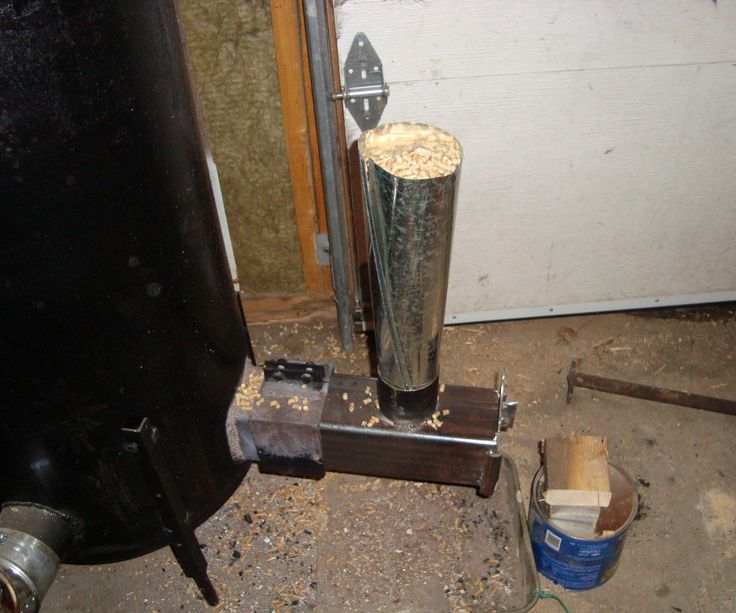 Hi,  This is my gravity fed pellet burner. The air intake and the feeding rate can be adjusted depending on the intensity of heat needed. Set to the minimum feeding rate,  i get over 8 hrs of heat with a 40 pound bag of wood pellets. Together the rocket stove and the burner work better then i expected,   Wood pellet are cheap and easy to find.   Since wood pellets are made from recycled wood, i guess this is somme kind of green way to heat my garage..