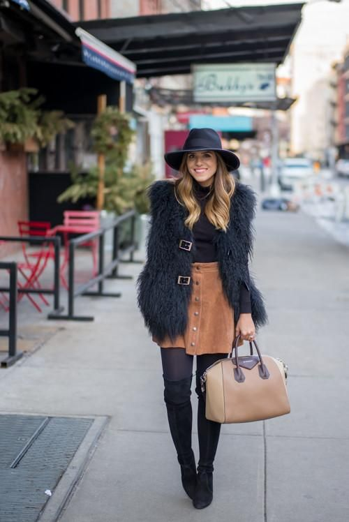 Brown Suede Skirts Are Spring 2015s Biggest Trend | Shaggy black boho vest over a long sleeve turtleneck worn with a chic suede skirt, a wide-brimmed hat, and black over the knee boots