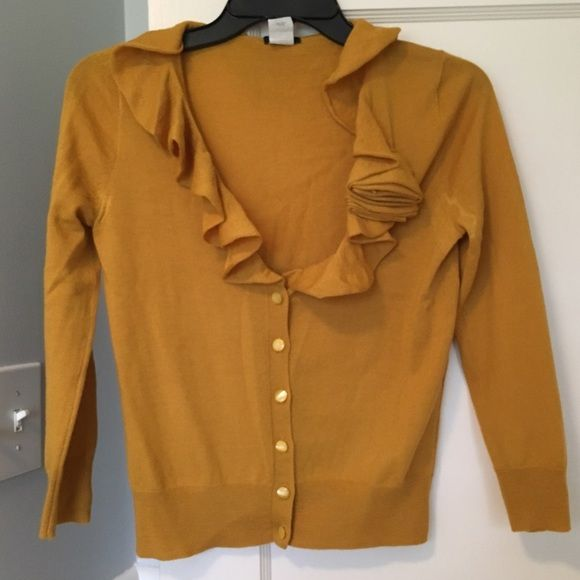 J.Crew Cardigan Mustard yellow 100% Merino Wool J.Crew Cardigan. Really cute! There's a small deodorant stain on left arm pit that could probably be removed with dry cleaning. J. Crew Sweaters Cardigans