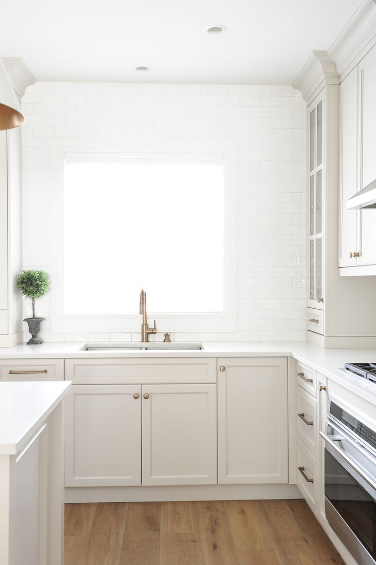 Stunning transitional taupe kitchen by Chrissy Cottrell: Chrissy & Co