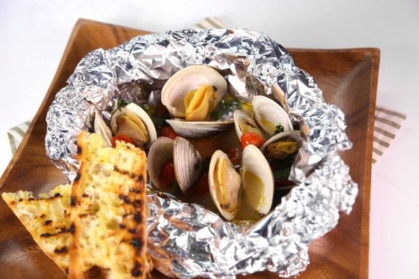 Steamed clams with chorizo and jalapenos   on the grill or in the oven at 500 degrees