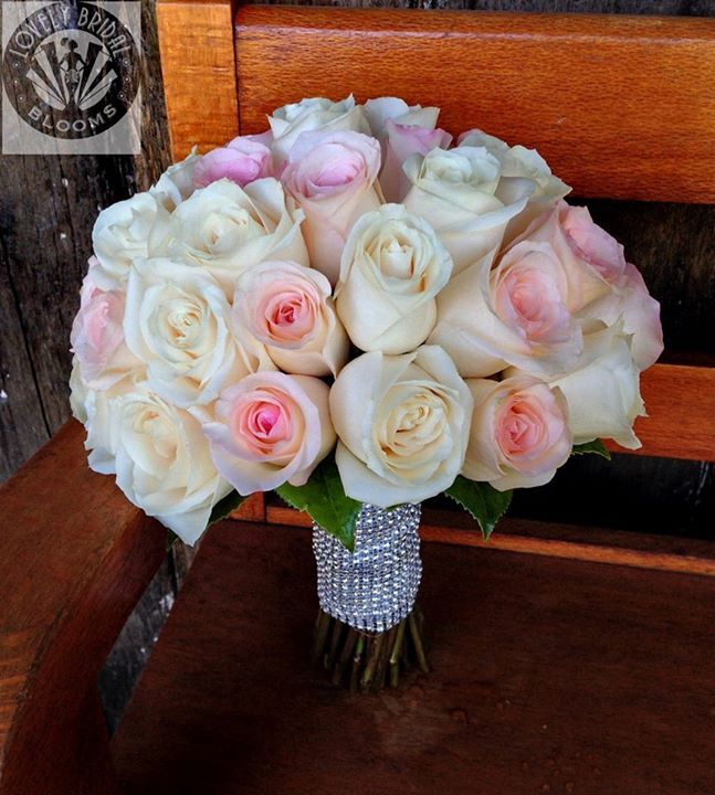 Bouquet of soft pink roses and ivory roses, created by Lovely Bridal Blooms
