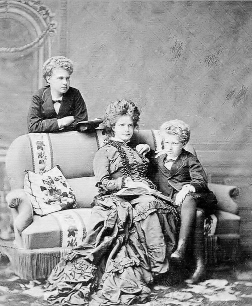 Queen Maria Pia of Portugal with her sons, left, Infante Carlos and Infante Alfonso