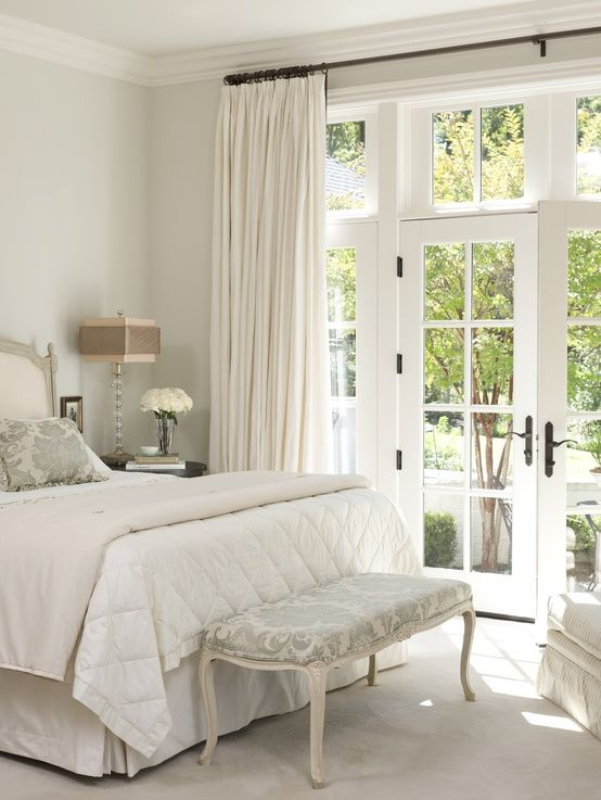 Lovely guest bedroom - so fresh and crisp - have to love having french doors in a bedroom!