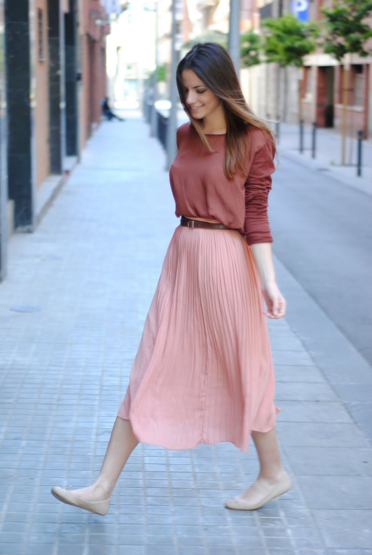 Pink pleated midi skirt, brown belt, mauve top, nude flats