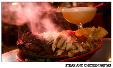 SIZZLING FAJITAS - Our sizzling Fajitas are smothered with sautéed peppers and onions. Served with crisp lettuce, diced tomatoes, cheddar cheese, sour cream, salsa, and soft tortillas.  Chicken - $12.99, Shrimp - $12.99, Steak - $14.99