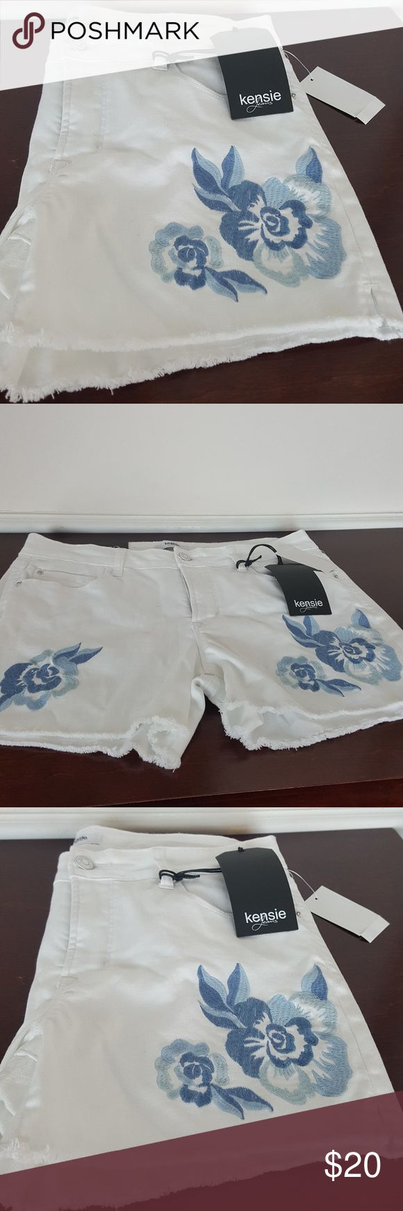 "Kensie Jeans Flower Embroidered Cut Off Shorts NWT White Denim Frayed Cut Off Shorts. Embroidered blue flowers. Button and Zip Fly. 5 Pocket Style. Size 8/29 Waist 29"" Inseam 4"" Rise 9"" Kensie Jeans Shorts Jean Shorts"