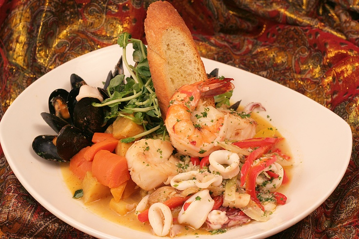 Seafood Royale!  A combination of Shrimp, Calamari, and Mussels served over a bed of rice!      www.thesultanstent.com