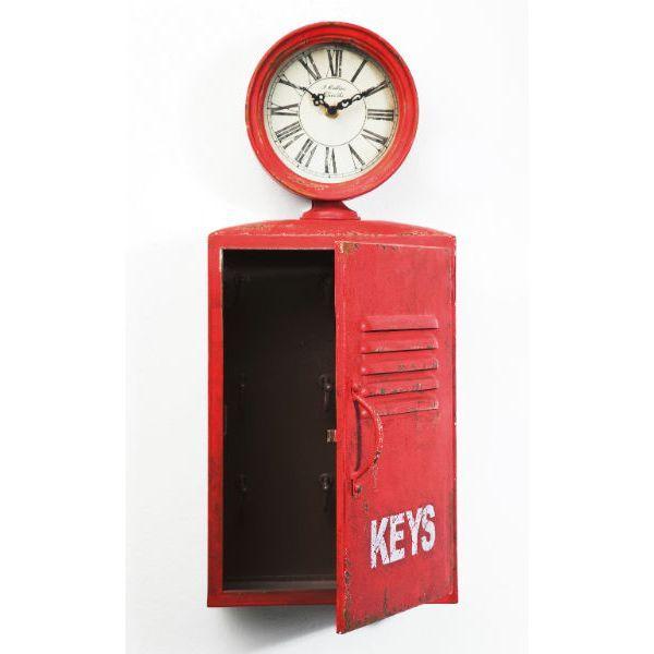 Ρολόι τοίχου Air Pressure Το ρολόι αυτό, μεταλλικό σε κόκκινο χρώμα με τεχνητή παλαίωση, αποτελεί μια έξυπνη λύση για όσους θέλουν να διακοσμήσουν έναν τοίχο του σπιτιού τους αλλά και να τον αξιοποιήσουν ως αποθηκευτικό χώρο, μιας και λειτουργεί και ως ντουλαπάκι – κλειδοθήκη. Λειτουργεί με μια απλή μπαταρία 1xAA