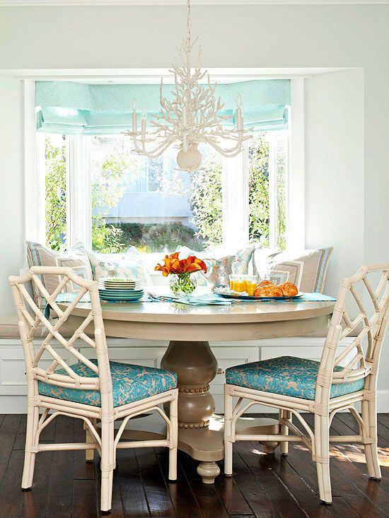 A single-color palette makes it easy to mix patterns in this elegant dinning area. Tour the rest of this cottage-style home: http://www.bhg.com/decorating/decorating-style/cottage/small-elegant-cottage/?socsrc=bhgpin042313tealbanquette=2