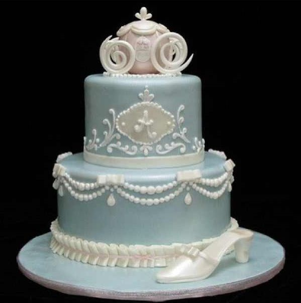 Disney/Cinderella wedding cake with Cinderella's coach on top. This cake has so many lovely details.