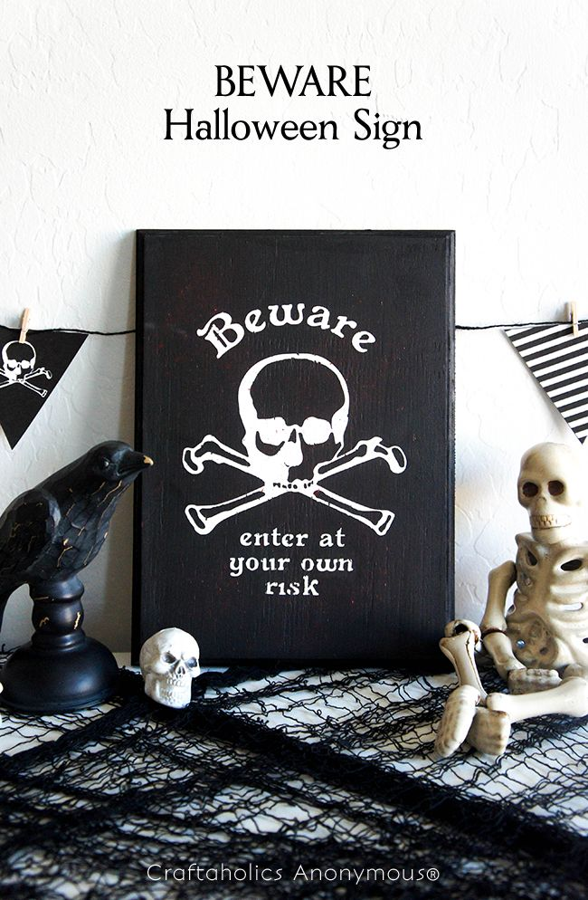 This BEWARE Halloween sign is so easy to make and perfect for creepy DIY Halloween decor! Add some red paint to up the spooky look of this creepy sign.