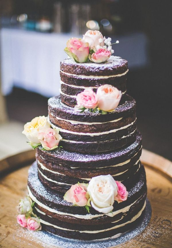 4 tiered dark chocolate brownie naked wedding cake filled with vanilla bean buttercream