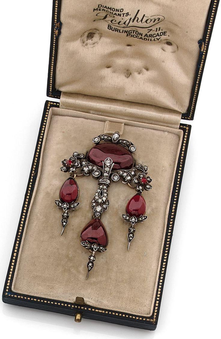 A Victorian antique silver, silver gilt, garnet and diamond brooch, by Leighton, English, 19th century. 7 x 3.8cm. #antique #Victorian #brooch