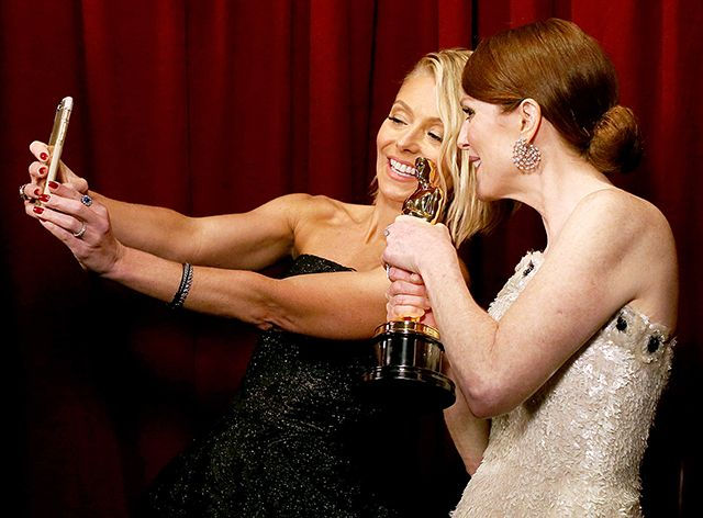 Kelly Ripa and Julianne Moore take a selfie after she wins Oscar for Best Actress on Feb. 22.