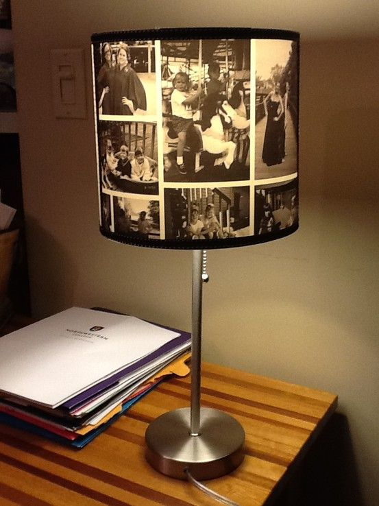 I LOVE this! I can have some of my favorite pics right on the bedside table without cluttering a small space. Especially awesome with a bright colored lamp base I think!