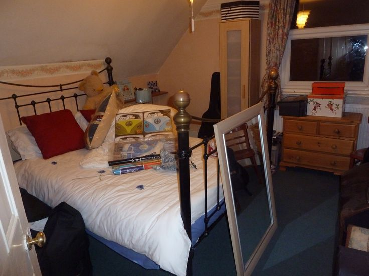 """Coast room - top floor guest room with sea/Langstone Harbour views!  As it was pre-renovation….walls behind bed now """"squared off"""" and ensuite has taken some of the space from left side."""