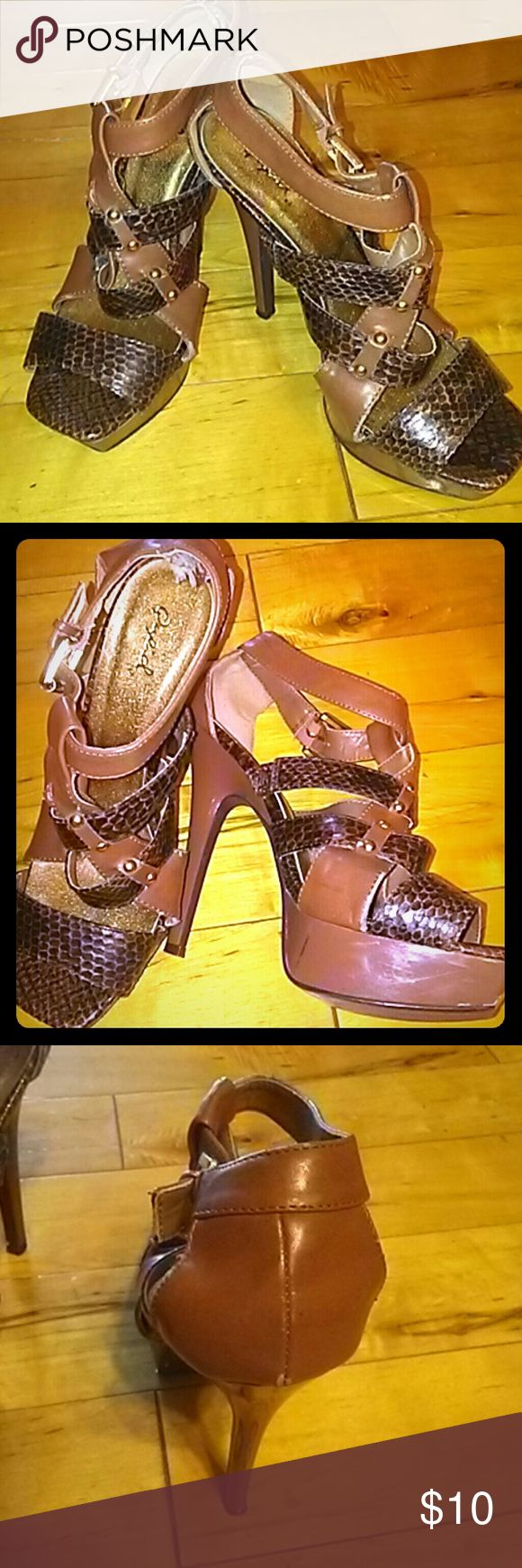 Sexy snakeskin Heels very chic Dark brown tan carmal color with touch of blk oupid Heels gorgeous.wear with your favorite jeans or dress oupid Shoes Heels