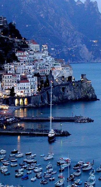 Amalfi, Italy.  Amalfi is a town and comune in the province of Salerno, in the region of Campania, Italy, on the Gulf of Salerno, about 47 kilometres southeast of Naples.