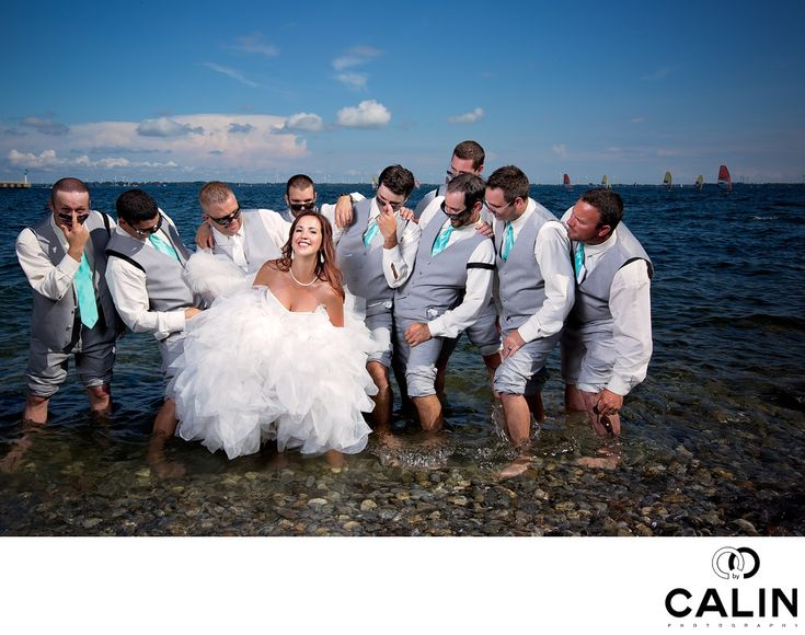 Photography by Calin - This fun photo of the bride and the groomsmen was taken a few steps from the Harbour Restaurant in Kingston, Ontario.&nbsp,    It was a hot summer day and the bridal party was extremely energetic. They have known each other since elementary school and the wedding was a huge event.&nbsp,    After the bride got her makeup and hair done,&nbsp,we went to a local pub called&nbsp,        Merchant tap House for some fun photos. Beer was flowing and that removed the last…