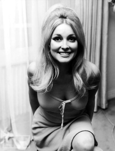 "Sharon Tate smiles for the camera in 1967. Murdered by Charles Manson's followers on Aug. 9, 1969, she was two weeks away from giving birth. The Manson ""family"" committed several other brutal murders in the same time period for which they were later convicted and sentenced to death which was later commuted to life imprisonment the State of California abolished the death penalty.  A horrific crime."
