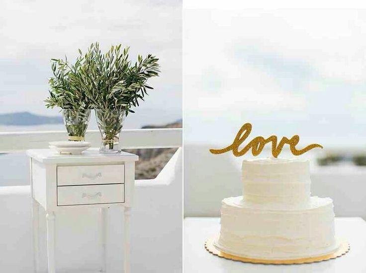Wedding  cake, white froasting cream , cake top LOVE ,vases with olive leaves, total white decoration,  wedding  destination,  wedding  in greece,  wedding  flowers, flower decoration www.santoweddingsbymk.com