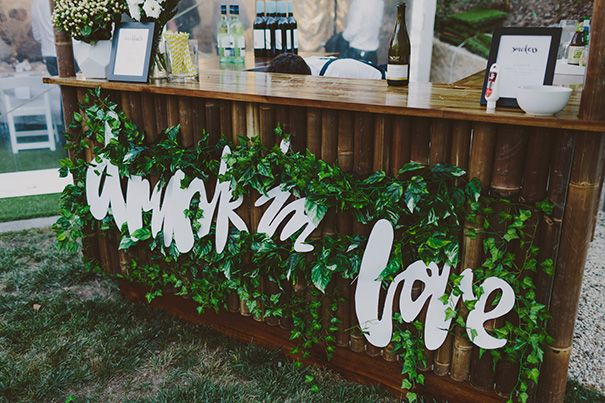 """Drunk in Love"" or another slogan can be used within the greenery to cover a bar front."