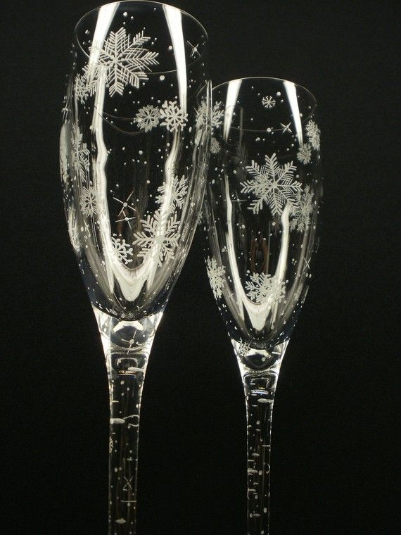 "$47.50 Two 6.75 oz., 9"" high, hand engraved champagne flutes. Beautifully hand engraved with 'Floating Flakes' wrapping each glass. These elegant glasses are perfect as gifts, for winter weddings, anniversary or on display. Perfect for any outdoor celebration. Every flute is unique. Hand engraved. Every glass is one of a kind. There will never be two pieces exactly alike. These engravings are not traced. Every piece is created freehand. Each glass is a signed original."