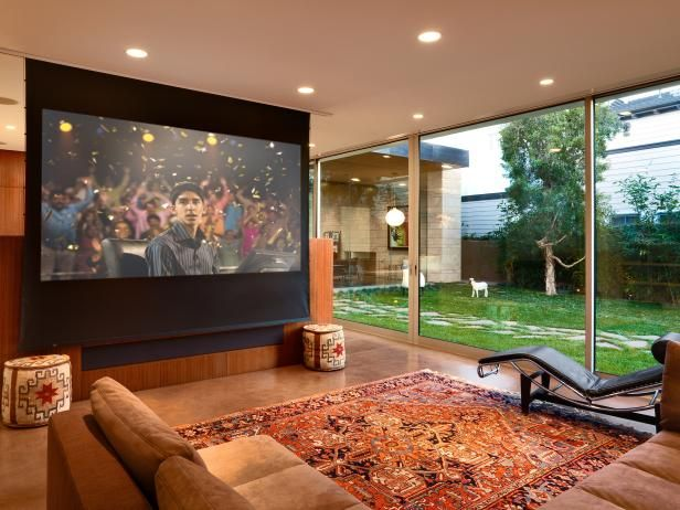 DIY Network shows you how to mount a large projector screen onto a wall or ceiling.